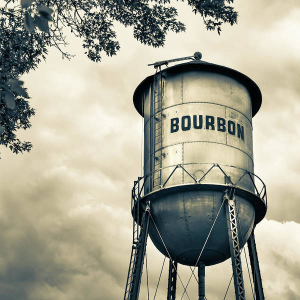 Photograph - Bourbon Whiskey Water Tower And Clouds - Vintage Sepia Edition by Gregory Ballos