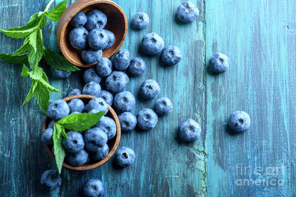Wall Art - Photograph - Bowl Of Fresh Blueberries On Blue Rustic Wooden Table From Above by Jelena Jovanovic