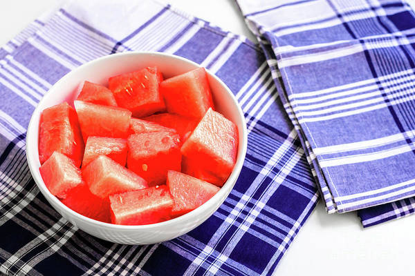 Photograph - Bowl With Pieces Of Red Watermelon On A Blue Napkins On White Ba by Joaquin Corbalan