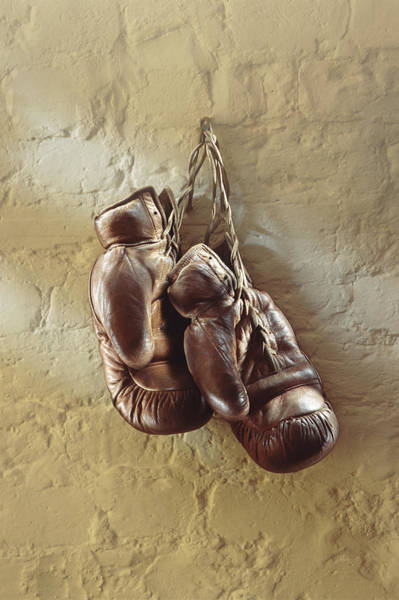 Plaster Photograph - Boxing Gloves Hung Up On Wall by Romilly Lockyer