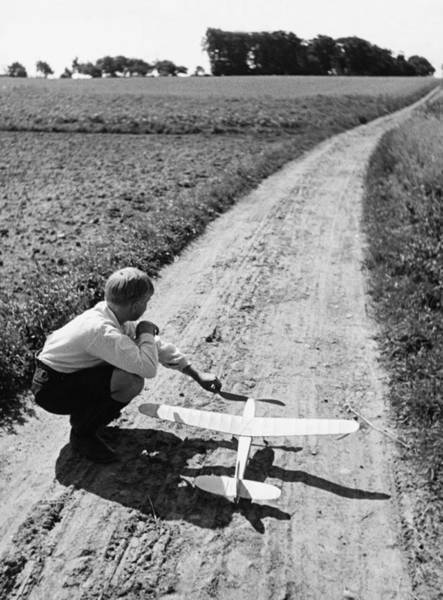 One Way Road Photograph - Boy 10-12 With Model Plane On Dirt Path by Hulton Archive