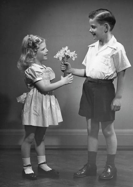 Wall Art - Photograph - Boy Giving Flowers To Girl by George Marks