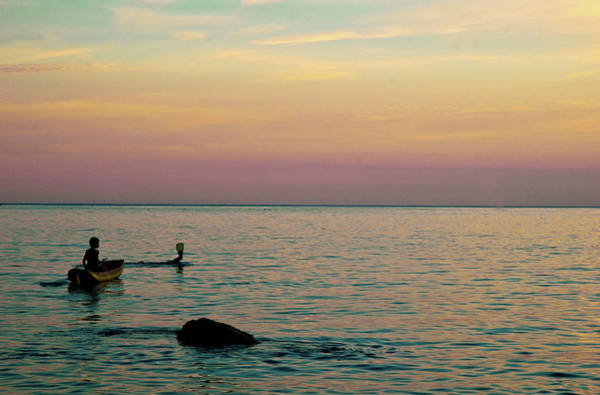 Snorkeling Photograph - Boy In Boat At Sunset by Ju Fumero