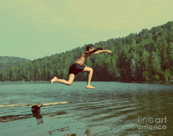 Wall Art - Photograph - Boy Jumping In Lake At Summer Vacations by Kokhanchikov