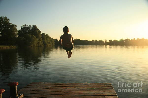 Childhood Wall Art - Photograph - Boy Jumping Into A Lake From A Dock At by David Polite