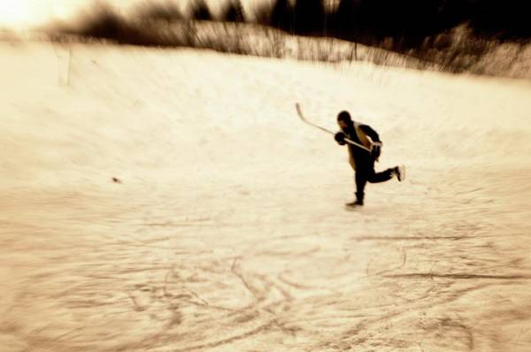 Sentimentality Photograph - Boy Playing Pond Hockey by Kevin Spreekmeester