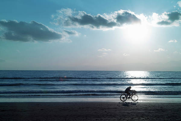 Wall Art - Photograph - Boy Running On The Beach By Bicycle by Hiroshi Watanabe