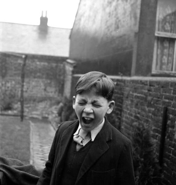 Reportage Photograph - Boy Yawning by Maurice Ambler