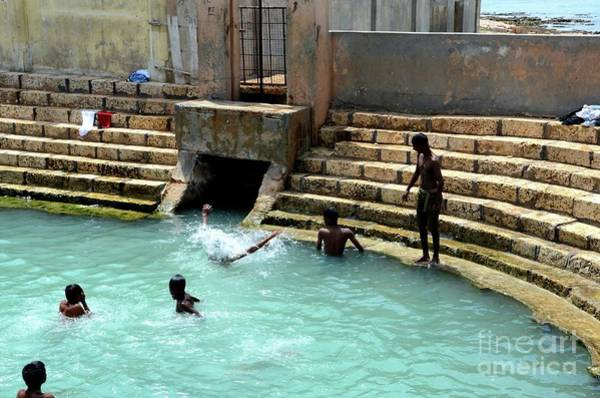 Photograph - Boys Play And Bathe In Keerimalai Fresh Water Spring Tank By Ocean Water Jaffna Sri Lanka by Imran Ahmed
