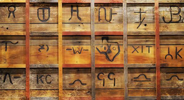 Branding Iron Photograph - Branding Wall by Gaby Ethington