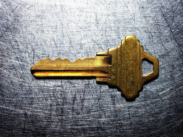 Protection Photograph - Brass Key On Stainless Steel by Ballyscanlon