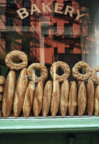 Photograph - Bread In Bakery Window In New York by Alan Becker