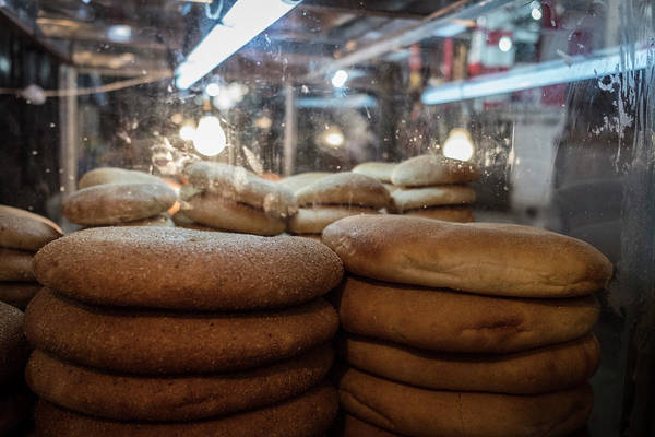 Wall Art - Photograph - Bread On Display Waiting To Be Sold In The Medina Of Fes by Ruben Vicente
