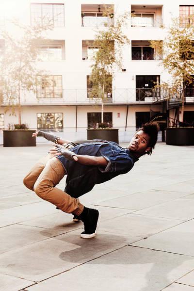 Bending Photograph - Break Dancer At Courtyard by John And Tina Reid