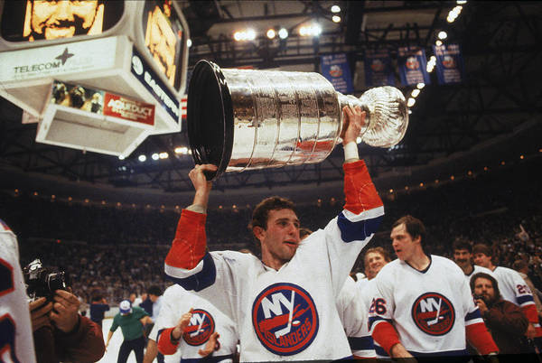 Stanley Cup Playoffs Photograph - Brent Sutter Holds Up The Stanley Cup by B Bennett