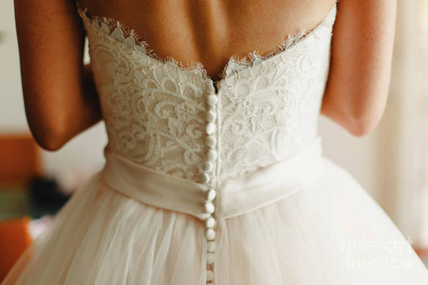 Bride Getting Ready, They Help Her By Buttoning The Buttons On The Back Of Her Dress. Art Print