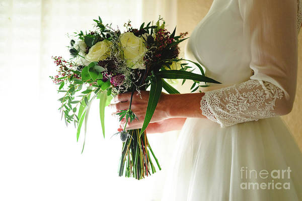 Photograph - Bride Holding Her Wedding Bouquet by Joaquin Corbalan