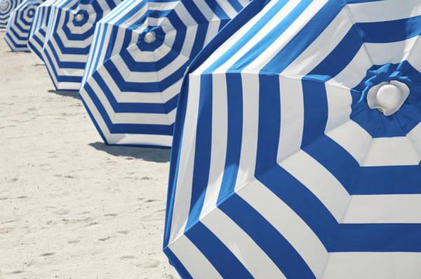 Horizontal Stripes Photograph - Bright Blue And White Striped Beach by Peskymonkey