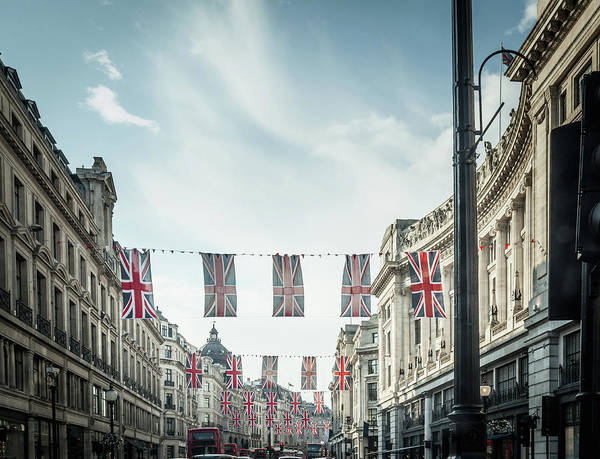 Hanging Photograph - British Flags Hanging Over City Street by Dan Brownsword
