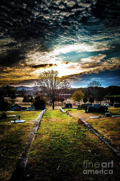 Photograph - Brooding Sky Over Cemetery by James L Bartlett