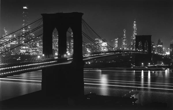 Photograph - Brooklyn Bridge At Night Against by Andreas Feininger