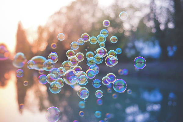 Colored Bubbles Photograph - Bubbles Floating by Eugenio Marongiu