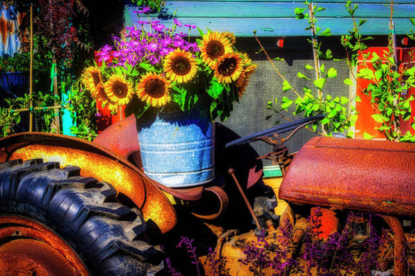 Traction Photograph - Bucket Of Sunflowers On Old Tractor Seat by Garry Gay