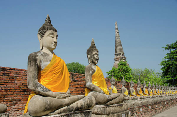 Stupa Photograph - Buddha Statues Dressed In Yellow Robe by Danita Delimont