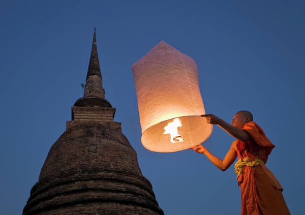 Shaved Head Photograph - Buddhist Monk Holding Khom Loy Lantern by Martin Puddy