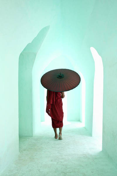 Myanmar Wall Art - Photograph - Buddhist Monk Walking Along Arched by Martin Puddy