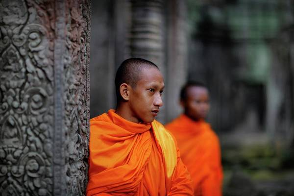 Shaved Head Photograph - Buddhist Monks At Angkor Wat Temple by Timothy Allen