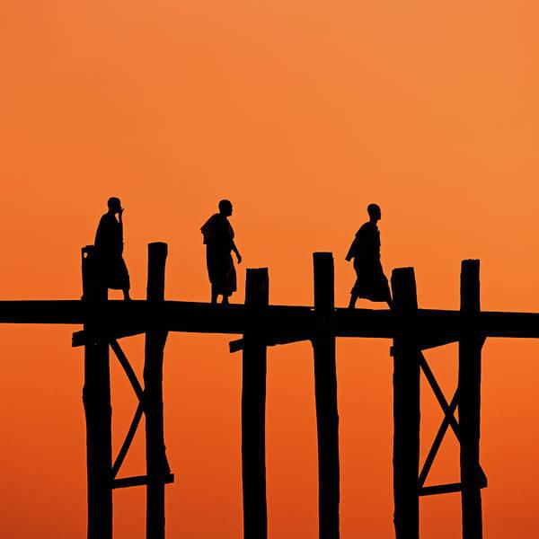 Shaved Head Photograph - Buddhist Monks Crossing U Bein Bridge by Hadynyah