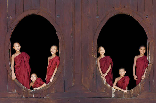 Shaved Head Photograph - Buddhist Monks In Window Of Monastery by Martin Puddy