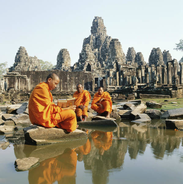 Cambodian Photograph - Buddhist Monks Sitting In Front Of by Martin Puddy