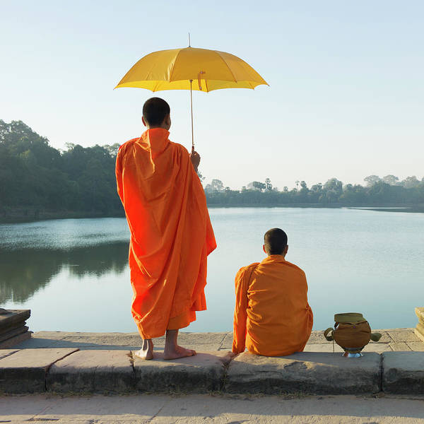 Reap Photograph - Buddhist Monks Standing In Front Of by Martin Puddy