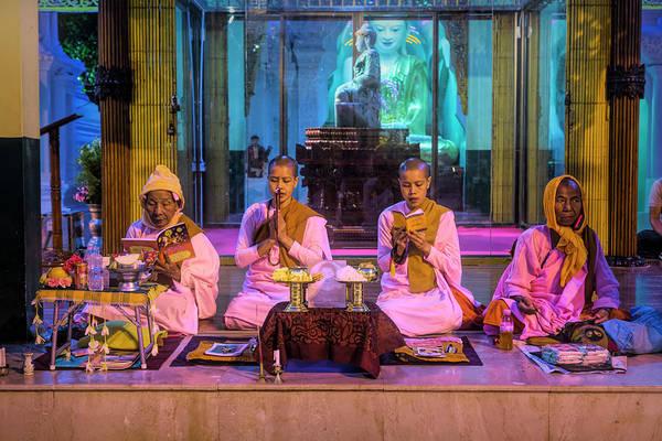Wall Art - Photograph - Buddhist Nuns In Prayer by Lindley Johnson
