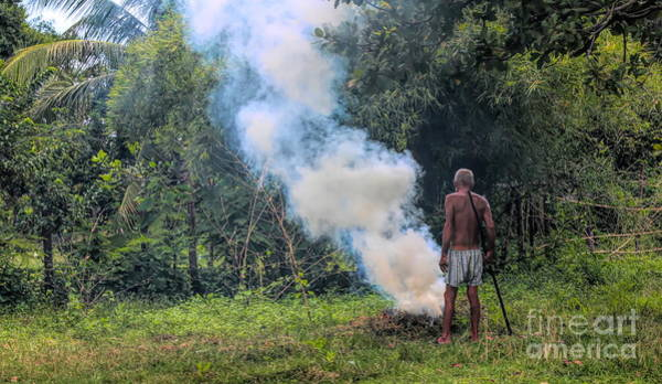 Wall Art - Photograph - Burning Weeds Landscape Cambodia Old Man  by Chuck Kuhn