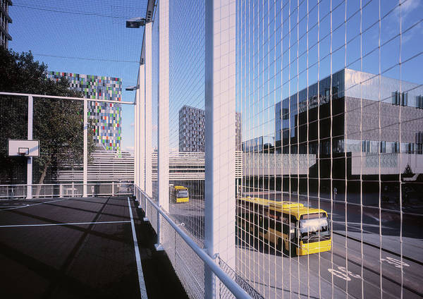 Court Photograph - Bus Passing Elevated Basketball Court by Eschcollection