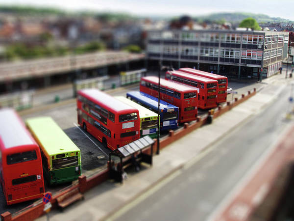 Side-by-side Photograph - Bus Station With Several Parked Buses by Paula Bailey