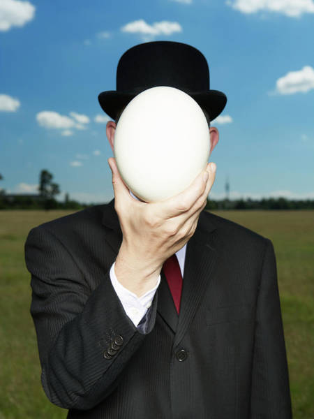 Wall Art - Photograph - Business Holding Egg In Front Of Face by Erik Dreyer