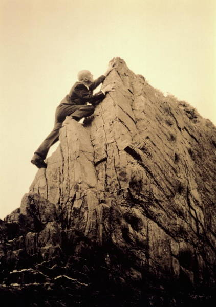 Climbing Photograph - Businessman Climbing Jagged Rock, Low by Betsie Van Der Meer