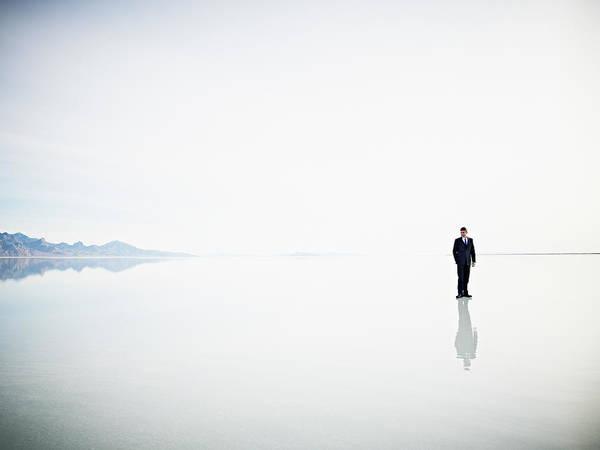 Wall Art - Photograph - Businessman Standing Alone On Surface by Thomas Barwick