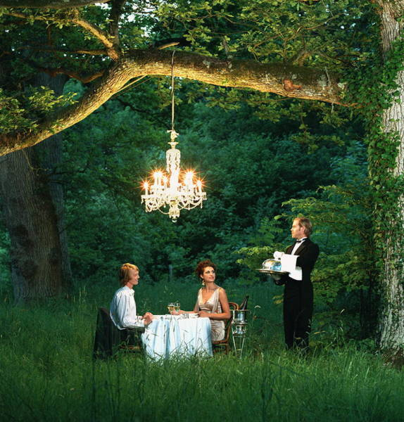 Waiter Photograph - Butler Waiting On Young Couple Dining by Martin Barraud