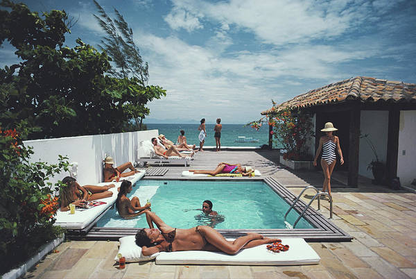 Group Of People Photograph - Buzios by Slim Aarons