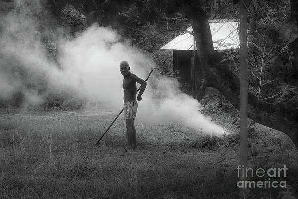 Wall Art - Photograph - Bw Older Cambodian Male Burning Weeds  by Chuck Kuhn