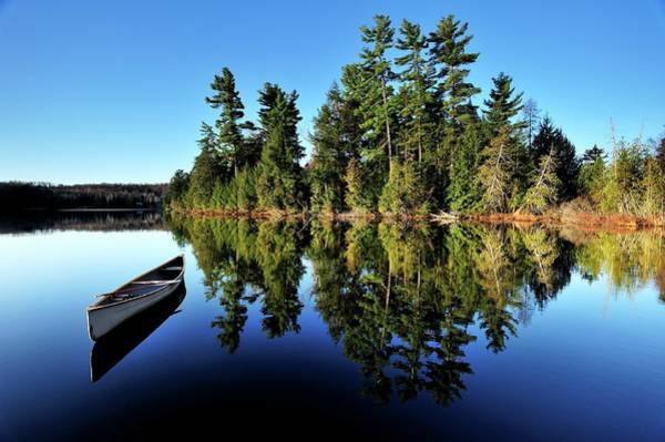 Eagle Photograph - Canoe & Pines On A Northern Lake by Peter Bowers