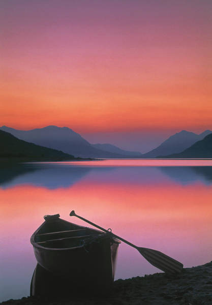 Lakeshore Photograph - Canoe On Shore At Sunset by Darwin Wiggett