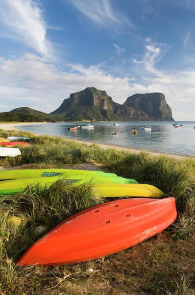 Canoe Photograph - Canoes And Kayaks Lining Lagoon Beach by Rachel Lewis