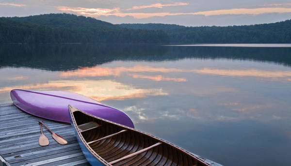 Canoe Photograph - Canoes And Paddles On Dock At Sunset by Mary Ellen Mcquay