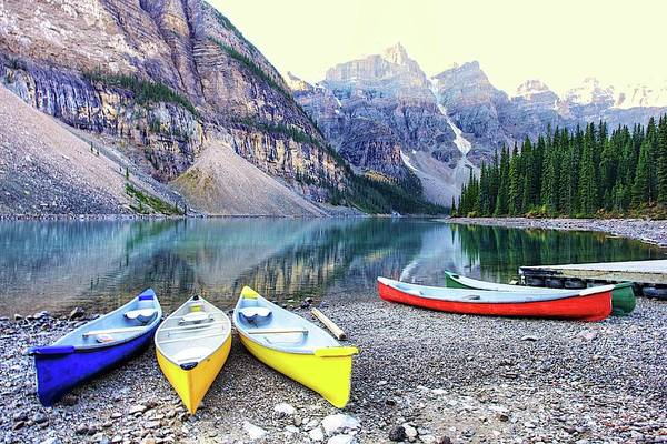 Moraine Lake Photograph - Canoes At Moraine Lake, In Explore by J.p.andersen Images